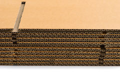 Stack of corrugated cardboard boxes. side perspective view of fl Royalty Free Stock Photos