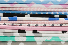 Stack of cotton fabric material background. Stack of 100% cotton fabric material for tailor or homework background Royalty Free Stock Photos
