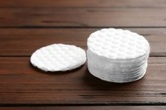 Stack of cotton pads on wooden stock photos