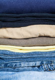 Stack of cotton shirt and blue jean Stock Photography