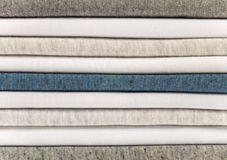 Stack of cotton t-shirts. Stack of white, gray and heather blue t-shirts Royalty Free Stock Photography
