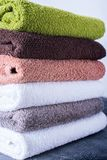 Stack cotton terry bath towels colorful textile Royalty Free Stock Images