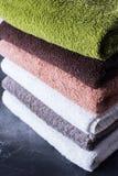 Stack cotton terry bath towels colorful textile Stock Photos