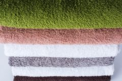 Stack cotton terry bath towels colorful textile Stock Images