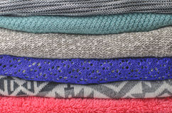 Stack of cozy colorful sweaters Stock Images