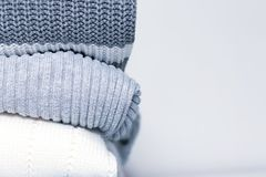 Stack of cozy comfortable homely clean washed knitted sweaters in pastel colors, laundry and washing clothes concept with copy. Space royalty free stock images