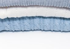 Stack of cozy comfortable homely clean washed knitted sweaters in pastel colors, laundry and washing clothes concept with copy. Space royalty free stock photos