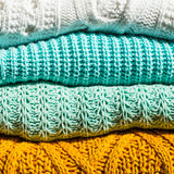 Stack of Cozy Cotton Knitted Sweaters Stock Images