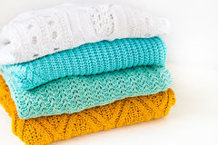 Stack of Cozy Cotton Knitted Sweaters Stock Photo