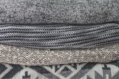 Stack of cozy knitted sweaters; Grey and Black tone. Stack of cozy knitted sweaters; Grey color and Black color tone in the winter season royalty free stock photos