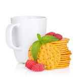 Stack of crackers with mint, berries and cup of drink Royalty Free Stock Photo