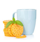 Stack of crackers with mint and cup of drink Stock Images
