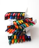 Stack Of Crayon Boxes Over White. Colorful Crayons Royalty Free Stock Images