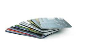 Stack of Credit Cards. With shallow DOF (focus on cards tips, card expired and account number is longer active) on the White Background Stock Photo