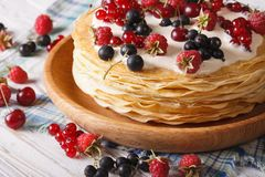 Stack crepes with berries close-up on a plate. Horizontal Stock Photos