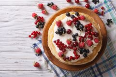 Stack of crepes with berries and cream horizontal top view Royalty Free Stock Photos