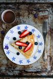 Crepes with blueberries and strawberries stock photo