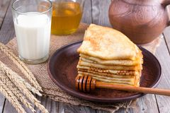 Stack of crepes or pancakes for Maslenitsa. Stack of classic Russian thin pancakes bliny or crepes with honey on a plate. Traditional for the Russian pancake royalty free stock images