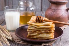Stack of crepes or pancakes for Maslenitsa. Stack of classic Russian thin pancakes bliny or crepes with honey on a plate. Traditional for the Russian pancake stock images