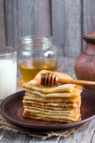 Stack of crepes or pancakes for Maslenitsa. Stack of classic Russian thin pancakes bliny or crepes with honey on a plate. Traditional for the Russian pancake royalty free stock image