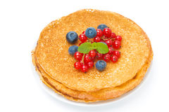 Stack of crepes with red currants and blueberries on a plate Stock Images