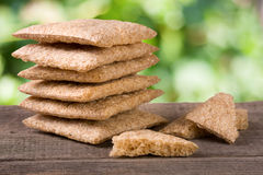 Stack of crisp bread on a wooden table isolated white background Royalty Free Stock Images
