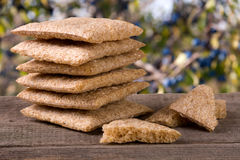 Stack of crisp bread on a wooden table isolated white background Royalty Free Stock Photo