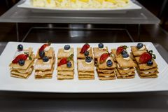 Stack of crispy pancake with banana slice topping of strawberry, Royalty Free Stock Photos