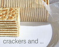 Stack of crispy soda crackers on plate to be enjoyed plain or with a topping Royalty Free Stock Photography