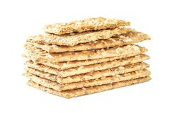 Stack of crispy wheat flatbread crackers with seeds isolated on. A white background Royalty Free Stock Photo