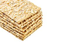 Stack of crispy wheat flatbread crackers with seeds isolated on. A white background Stock Photo