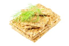 Stack of crispy wheat flatbread crackers with sprig of dill isol. Ated on a white background Royalty Free Stock Images