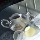 Stack of crockery. In a metal tray, outdoor close-up royalty free stock image