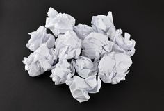 Crumpled white papers isolated on black. Stack of crumpled white papers isolated on black stock photo