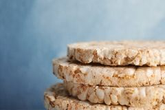 Stack of crunchy rice cakes on color background, closeup. Space for text stock photography