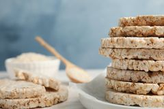 Stack of crunchy rice cakes on table, closeup. Space for text royalty free stock images