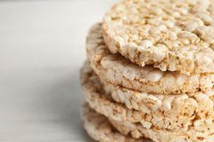 Stack of crunchy rice cakes on white background, closeup. Space for text stock image