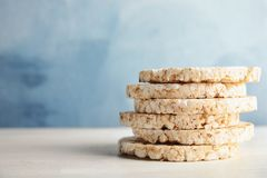 Stack of crunchy rice cakes on white table. Space for text royalty free stock photos