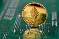 Stack of cryptocurrencies in a circle with ethereum on the top on motherboard, close-up, selective focus. Stack of cryptocurrencies in a circle with ethereum on royalty free stock photos