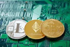 Stack of cryptocurrencies in a circle with ethereum on the top on motherboard, close-up, selective focus. Stack of cryptocurrencies in a circle with ethereum on stock photography