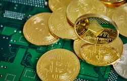 Stack of cryptocurrencies in a circle with ethereum on the top on motherboard, close-up, selective focus. Stack of cryptocurrencies in a circle with ethereum on royalty free stock photography