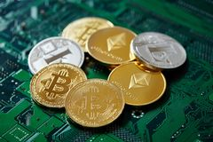 Stack of cryptocurrencies in a circle with ethereum on the top on motherboard, close-up, selective focus. Stack of cryptocurrencies in a circle with ethereum on stock photos