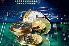 Stack of cryptocurrencies in a circle with ethereum on the top on motherboard, close-up, selective focus. Stack of cryptocurrencies in a circle with ethereum on stock photo
