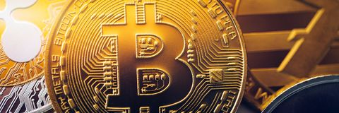 Stack of cryptocurrencies with a golden bitcoin. Bitcoin as most important cryptocurrency concept. Bitcoin. Physical bit coin. Digital currency. Cryptocurrency stock image