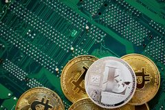 Stack of cryptocurrencies on motherboard. Bitcoin as most important cryptocurrency concept. 3D illustration. Stack of cryptocurrencies arranged on the stock photos