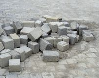 Stack of cubic tile laying on pavement Royalty Free Stock Image