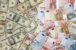 Stack of currency. Dollar and euro banknotes background Royalty Free Stock Photography