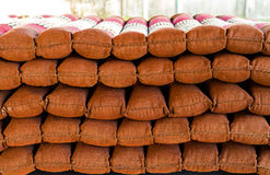Stack of Cushions  chair pillows pile. Vertical outdoor shot. Royalty Free Stock Photo