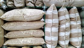 Stack of cushions. Retail. Soft brown colour cushions on display for sale Royalty Free Stock Photos