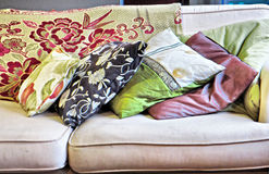Stack of cushions on sofa Royalty Free Stock Images